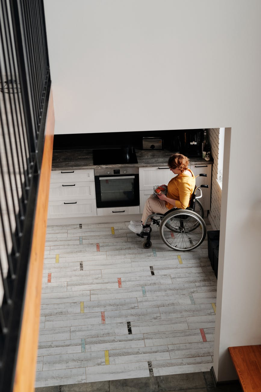 woman in wheelchair in kitchen
